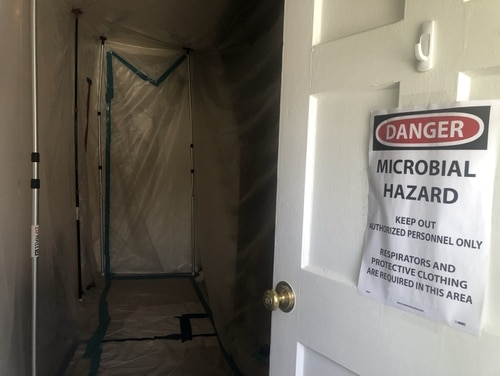 A sign on the Sarah Lynne Kline's home at West Point as contractors were removing mold in her home. (Courtesy Sarah Lynne Kline)