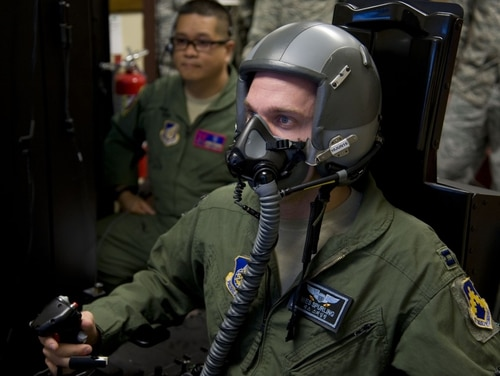 Capt. Wes Spurling, an 8th Operations Support Squadron operations flight commander, simulates flying while in a hypoxia familiarization trainer at Misawa Air Base, Japan, in May 2015. Pilots are required to participate in this training to understand how their bodies react to oxygen deficiency, known as hypoxia. (Airman 1st Class Jordyn Fetter/Air Force)