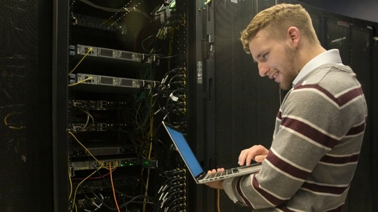 A veteran checking servers for Power Home Remodeling. Information Technology careers continue to be in high demand, and many of the employers listed in our 2018 rankings of the best companies for veterans to work at include significant IT components. (Power Home Remodeling)