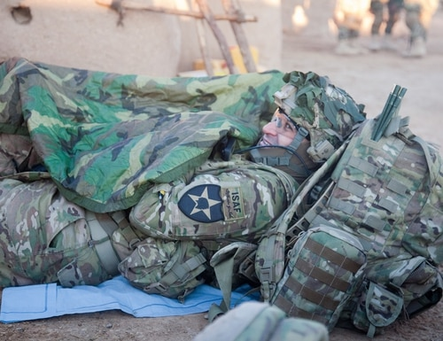 An Army captain covers himself with a poncho liner during a break during Operation Regular Flint at Shele Kalay, Kandahar province, Afghanistan, Jan. 16, 2012. (Spc. Kristina Truluck/Army)