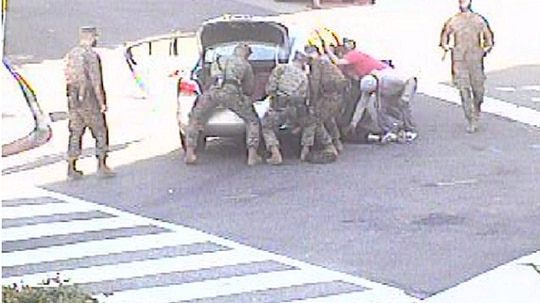 The quick thinking of Marines from the historic Marine Corps Barracks Washington helped save a woman trapped under a car. (Photo courtesy of Lance Cpl. Tanner Lambert and Lance Cpl. Allen Sanders/Marine Corps)