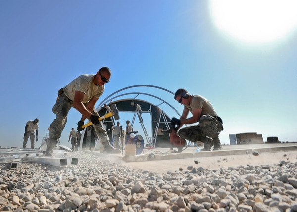 Staff Sgt. Adam Borjon, a 435th Construction Training Squadron engineer system's operator, and Senior Airman Allen Turner, a 435th CTS pavement and equipment operator, build structures Sept. 23, 2015, in support of personnel recovery operations at Diyarbakir Air Base, Turkey. The 435th Contingency Response Group deployed from Ramstein Air Base, Germany, in support of the U.S. Air Forces Central Command's staging aircraft and Airmen in southeast Turkey to enhance coalition capabilities to support personnel recovery operations in Syria and Iraq. (U.S. Air Force photo/Airman 1st Class Cory W. Bush)