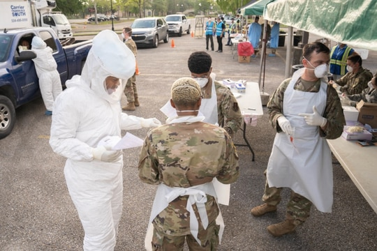 Louisiana National Guard Soldiers and Airmen test first responders for COVID-19 infections at Louis Armstrong Park, New Orleans, Louisiana, March 20, 2020. (U.S. Army National Guard photo by Staff Sgt. Josiah Pugh)