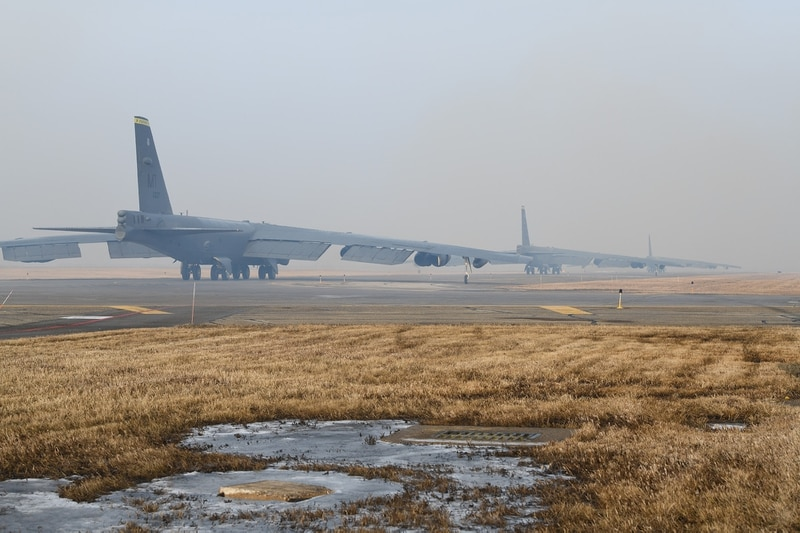 Three B-52H Stratofortress aircraft, assigned to the 5th Bomb Wing, taxi in preparation for a Bomber Task Force mission to the U.S. Central Command area of responsibility on March 6, 2021, at Minot Air Force Base, N.D. (Senior Airman Josh W. Strickland/Air Force)