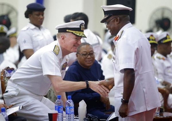 On Friday, Adm. Ibok-Ete Ekwe Ibas, right, Nigeria Chief of Naval Staff, shakes hands with Adm. James G. Foggo III, U.S. Naval Forces Europe-Africa , during the closing ceremony of exercise Obangame in Lagos. (Sunday Alamba/AP)