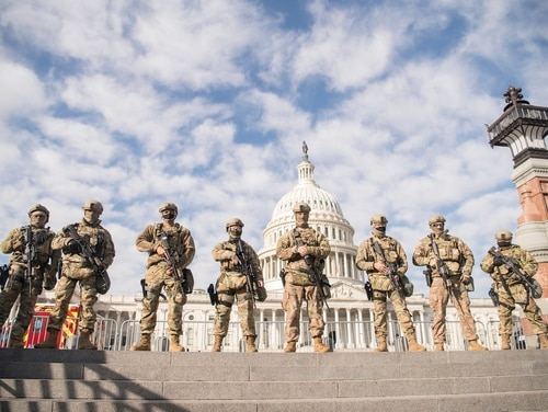 Virginia National Guard airmen assigned to the 192nd Security Forces Squadron secure the grounds near the U.S. Capitol, Jan. 13, 2021, in Washington. (Staff Sgt. Bryan Myhr/Air National Guard)
