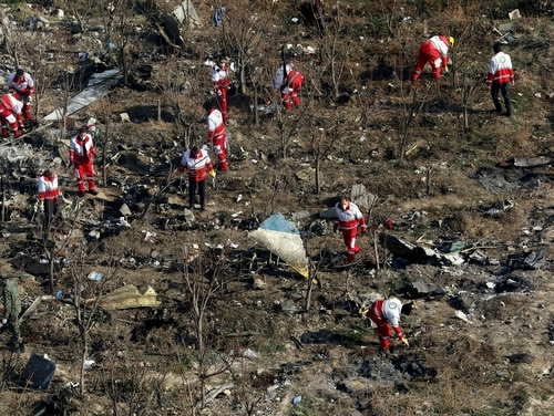 In this Jan. 8, 2020, photo, rescue workers search the scene where a Ukrainian plane crashed in Shahedshahr, southwest of the capital Tehran, Iran. (Ebrahim Noroozi/AP)
