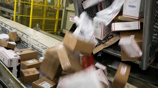 The State Department started proceedings that would take the U.S. out of a United Nations postal agreement in the next year. (Aaron P. Bernstein/Getty Images)