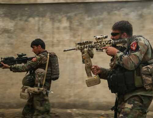 Commandos assigned to 1st Special Operations Kandak clear a training compound during breaching training in Laghman province, Afghanistan, on Feb. 13, 2018. (Sgt. Connor Mendez/U.S. Army)