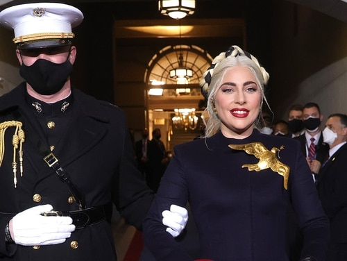 Lady Gaga is escorted by U.S. Marine escort Capt. Evan Campbell to sing the national anthem at the inauguration of U.S. President Joe Biden on the West Front of the U.S. Capitol on Jan. 20 in Washington, D.C. (Win McNamee/Getty Images)