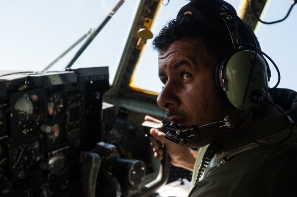 An Afghan Air Force C-130 Hercules pilot flies a training mission, Nov. 23, 2014, over Afghanistan. AAF C-130 pilots and loadmasters flew a training mission with their advisers from the 538th Air Expeditionary Advisor Squadron to Kandahar Air Field, and practiced landings. (U.S. Air Force photo by Staff Sgt. Perry Aston/Released)