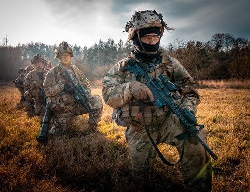 Paratroopers of the 173rd Airborne Brigade prepare to board a UH-60 Black Hawk for a live-fire air assault during Operation Rock Frost on Dec. 9 at Grafenwöhr Training Area, Germany. (Maj. Robert Fellingham/Army)