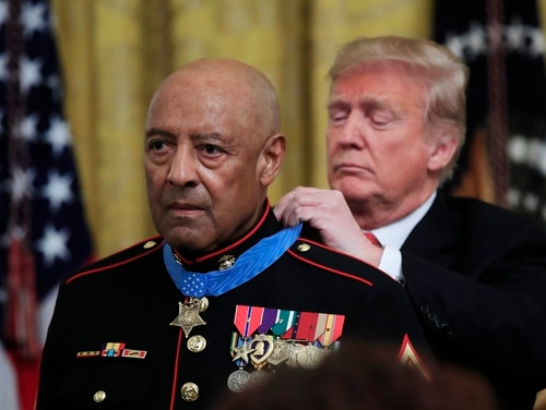 President Donald Trump presents the Medal of Honor to U.S. Marine Corps retired Sgt. Maj. John Canley, during an East Room ceremony at the White House in Washington, Wednesday, Oct. 17. Canley is the 300th Marine to receive the nation's highest military medal. (Manuel Balce Ceneta/AP)