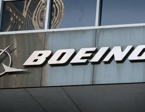 CHICAGO - JANUARY 28: A sign hangs above the entrance to The Boeing Company's headquarters on January 28, 2009 in Chicago, Illinois. (Photo by Scott Olson/Getty Images)