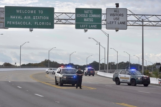 Police vehicles block the entrance to the Pensacola Air Base, Friday, Dec. 6, 2019 in Pensacola, Fla. (Tony Giberson/ Pensacola News Journal via AP)