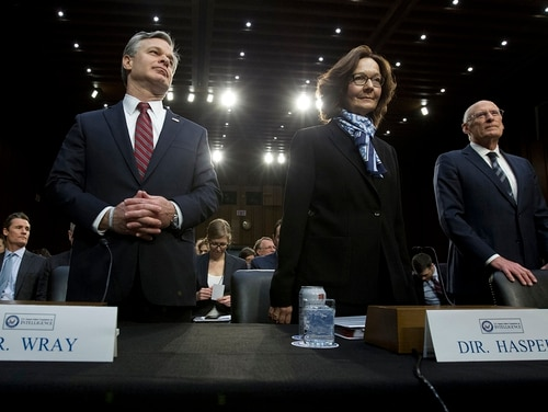 From left, FBI Director Christopher Wray, CIA Director Gina Haspel and Director of National Intelligence Daniel Coats arrive to testify before the Senate Intelligence Committee on Capitol Hill in Washington Tuesday, Jan. 29, 2019. (Jose Luis Magana/AP)