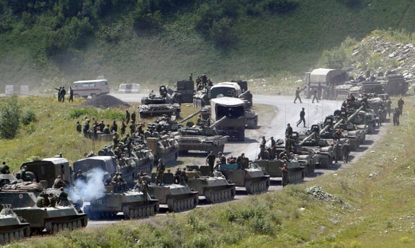 In this photo taken on Saturday, Aug. 9, 2008, a column of Russian armored vehicles head to Tskhinvali in the Georgian breakaway region of South Ossetia. (Musa Sadulayev, File/AP)