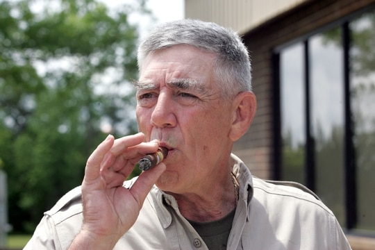 ** ADVANCE FOR MONDAY, MAY 22 ** Retired Marine Gunnery Sgt. R. Lee Ermey takes a break for a smoke outside New River Air Station's Staff NCO club, Monday, May 15, 2006, in Jacksonville, N.C. When people meet Ermey, the first thing they realize is his show-stopping turn as a Marine Corps drill instructor in the movie