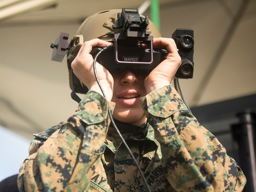 Lance Cpl. Preston Shay, a combat videographer with 2nd Marine Division Combat Camera uses an Augmented Immersive Team Trainer system during the Spartan Emerging Technology and Innovation Week on Camp Lejeune, North Carolina. (Cpl. Abraham Lopez, Marine Corps)