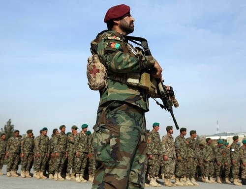 A national army forces stands guard during the graduation ceremony of newly Afghan National Army soldiers after a three month training program at the Afghan Military Academy in Kabul, Afghanistan, on Oct. 28, 2019. (Rahmat Gul/AP)