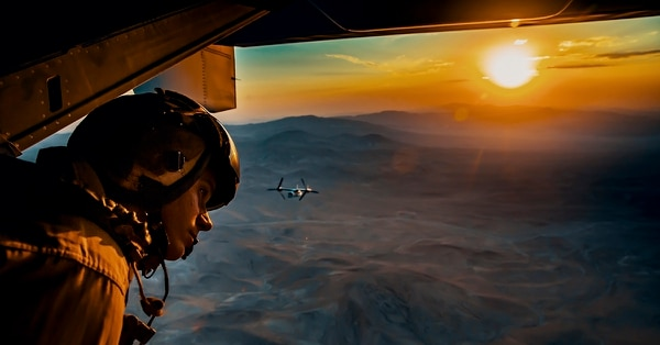 Sgt. Derek Levi looks over the landscape of Marine Corps Air Ground Combat Center, Twentynine Palms, California, during an aerial flight formation exercise August 12. (Lance Cpl. Rachel K. Young/Marine Corps)