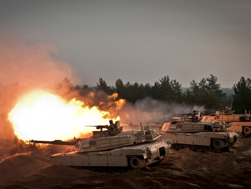 Soldiers from 1st Brigade Combat Team, 1st Cavalry Division fire from their M1A2 Abrams Tanks at the Adazi Training Area, Latvia, Nov. 6, 2014. (Sgt. 1st Class Jeremy J. Fowler/Army)
