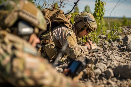 A Joint Terminal Attack Controller uses his Android Tactical Assault Tablet Kit during a close air support mission as part of a Northern Strike training exercise. (Scott Thompson/National Guard)