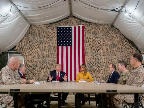 President Donald Trump, his wife, and senior advisers, speak to members of the media at Al Asad Air Base, Iraq, Wednesday, Dec. 26, 2018. (Andrew Harnik/AP)