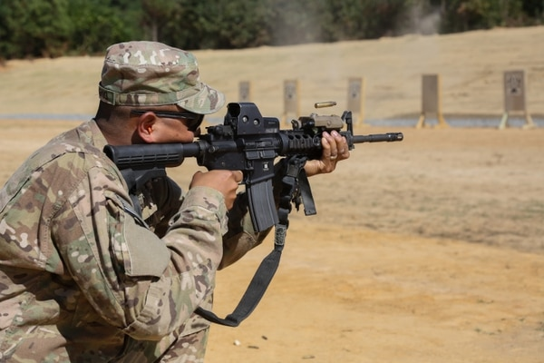 U.S. Army Sgt. Arthur Ruepong, assigned to the 55th Signal Company (COMCAM), fires his assigned M4 rrifle for a qualification range during a bi-annual Field Training Exercise (FTX), Fort AP Hill, Va., Sept. 23, 2015. The 55th Signal Company conducts a FTX twice a year in order to maintain tactical proficiency, as well as to develop and prepare Soldiers for the rigor of combat. (U.S. Army Photo by Sgt. 1st Class Christophe D. Paul/Released)