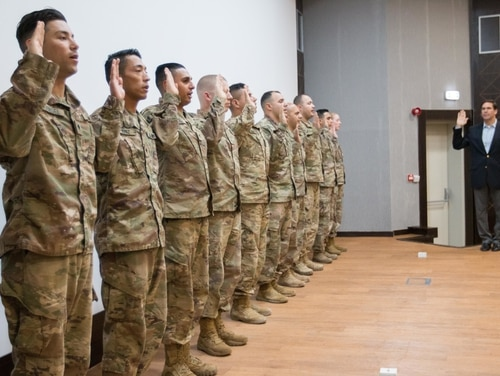 Army Secretary Mark Esper gives the oath of enlistment to soldiers during a reenlistment ceremony in December at the Joint Training Center in Jordan. (Sgt. 1st Class Brian A. Barbour)