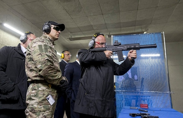 The CEO of the Rostec corporation test fires the AMB-17 (Photo Kalashnikov Concern)