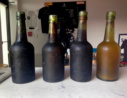 Four bottles recovered from the SS Oregon, a 133-year-old shipwreck, are shown at the Saint James Brewery in Holbrook, N.Y. Bill Felter of Serious Brewing in Howes Cave, N.Y., hoped to develop a new brew from ale salvaged from the SS Oregon. But the scuba-diving Long Island brewer, Adams, has scuttled those plans, saying he owns the shipwreck yeast and has used it to produce ale he's releasing in March 2019. (Jamie Adams via AP)