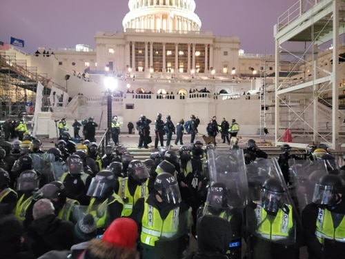 The steps in front of the Capitol building being reclaimed from by pro-Trump groups by police on Jan. 6, 2021. (Kyle Rempfer/Staff)
