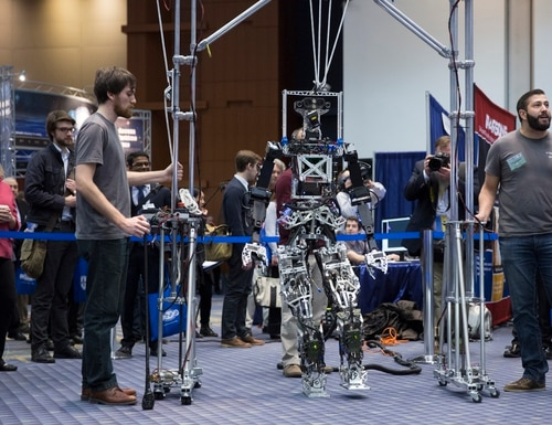 Researchers from Virginia Tech demonstrate the shipboard autonomous firefighting robot or SAFFIR at the Naval Future Force Science & Technology EXPO at Walter E. Washington Convention Center in Washington, D.C., on Feb. 4, 2015. (Mike Morones/Staff)