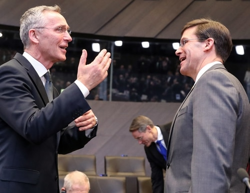 NATO Secretary-General Jens Stoltenberg (L), speaks with U.S. Defense Secretary Mark Esper during a NATO defense ministers meeting in Brussels on February 13, 2020, to address key issues including the alliances training mission in Iraq and the fight against international terrorism. (Photo by Aris Oikonomou/ AFP via Getty Images)