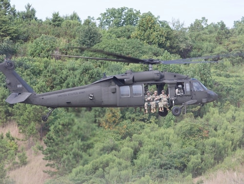 U.S. Army Soldiers with the 165th Quartermaster Company, Georgia National Guard take flight on an UH-60 Black Hawk during an airborne operation on Paulding County Airport in Dallas, Ga. The Army is testing upgrades to the aircraft's countermeasure system. (Sgt. Joshua Wooten/Army)