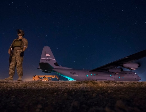 A security team watches over a C-130J May 26, 2017, during a cargo mission in Somalia. (Master Sgt. Russ Scalf/Air Force)