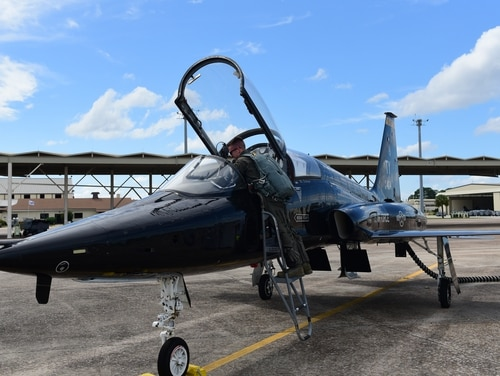 A T-38 pilot at Tyndall Air Force Base prepares to evacuate his aircraft to avoid the path of Hurricane Michael Oct. 8, 2018. (Senior Airman Cody Miller/Air Force)