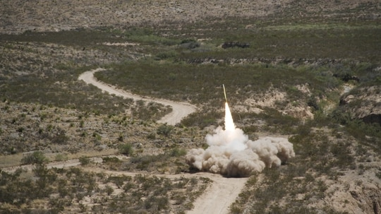 A GMLRS rocket launches from a High Mobility Artillery Rocket System during exercise Iron Rage at McGregor Range, N.M.. The rocket traveled just under 30 kilometers, impacting about 5 meters from the target. (Abigail Waldrop/U.S. Army)