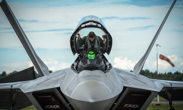 An F-22 pilot from the 95th Fighter Squadron out of Tyndall Air Force Base, Fla., prepares to take off from Ämari air base, Estonia, in September 2015. The Air Force is struggling with a shortage of fighter pilots and rolled out a series of incentives and new policies to convince pilots to stay in uniform. (Tech. Sgt. Ryan Crane/Air Force)