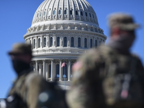 Members of the National Guard are seen patrolling near the U.S. Capitol Building on March 3. (Eric Baradat/AFP via Getty Images)