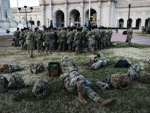 Members of the National Guard wait to depart Union Station as the city remains under tight security during the presidential inauguration on Jan. 20, 2021, in Washington. (Spencer Platt/Getty Images)