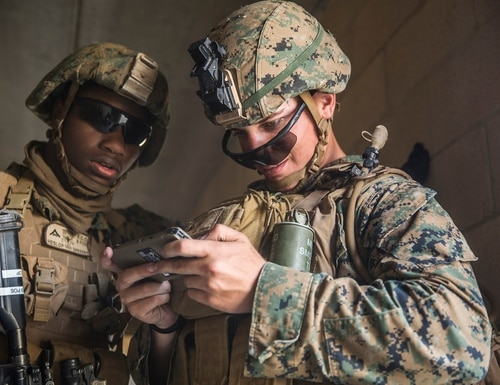 Marines look at an Android phone with enhanced radio capabilities. (Lance Cpl. Robert Alejandre/U.S. Marine Corps)
