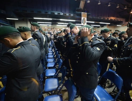 Soldiers from the John F. Kennedy Special Warfare Center and School don their green berets during a Regimental First Formation at the Crown Arena in Fayetteville, North Carolina on Sept. 26 2019. (K. Kassens/Army)