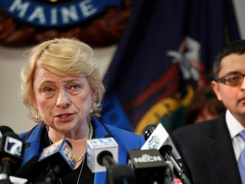 Gov. Janet Mills announces that one person has tested positive for coronavirus in Maine, during a Thursday news conference at the State House. Dr. Nirav Shah, director of the Maine Center for Disease Control and Prevention, is at right. (Robert F. Bukaty/Navy)