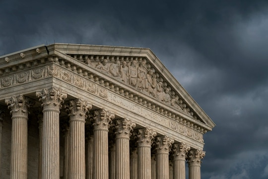 The Supreme Court is seen under stormy skies in Washington, Thursday, June 20, 2019. (AP Photo/J. Scott Applewhite)