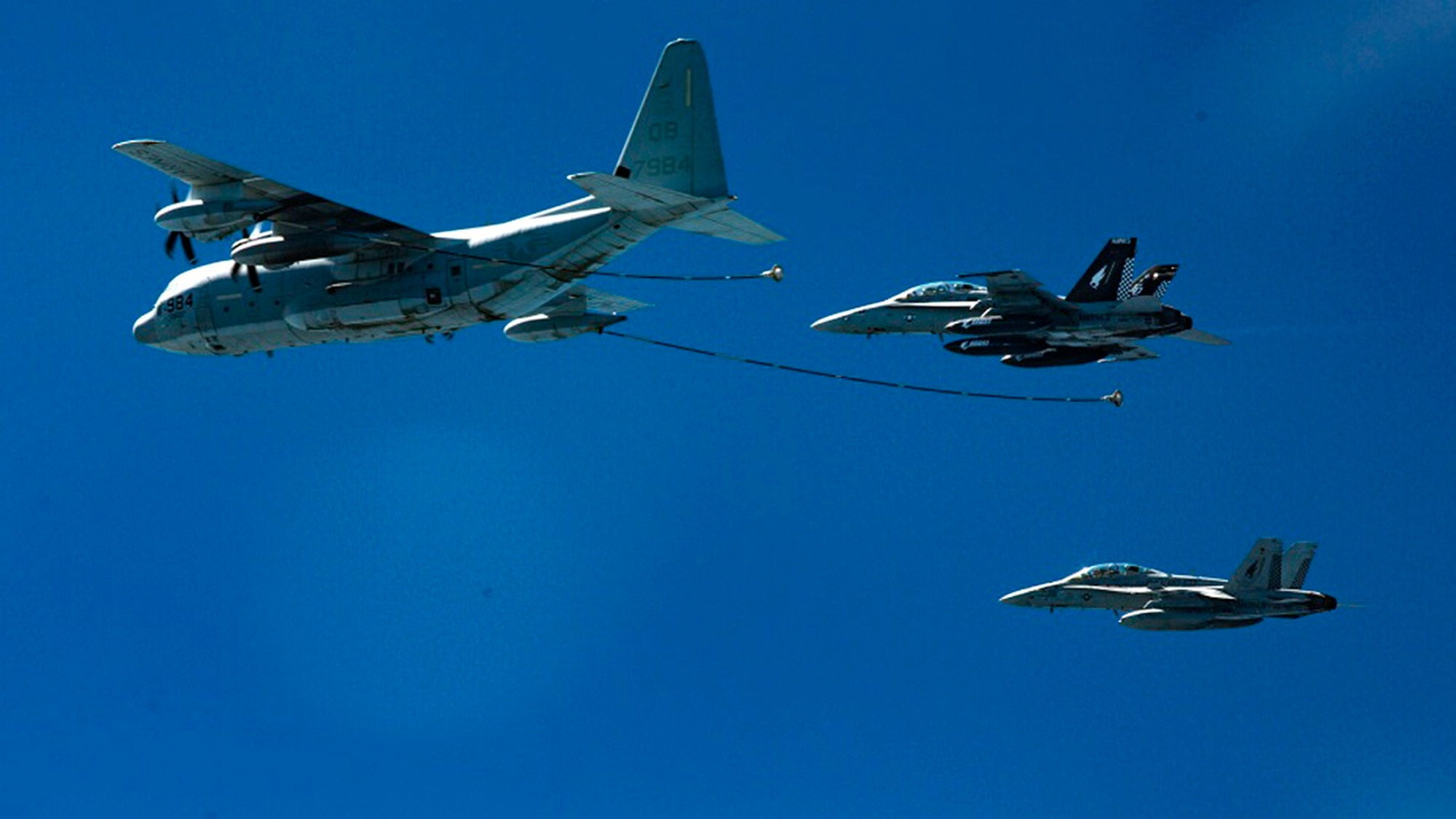 Two F/A-18D Hornets approach a KC-130J in 2016. (Cpl. Trever Statz/Marine Corps via AP)