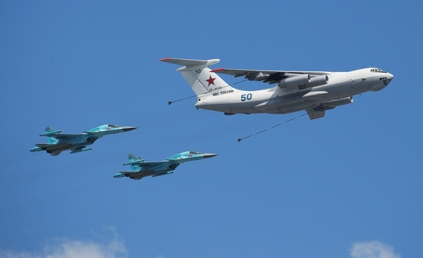 Russian Air Force Il-78 Midas tankers and Sukhoi Su-34 Fullback tactical bombers fly in formation for Russia's Victory Day parade. (RIA Novosti/Getty Images)