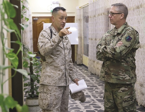 Marine Brig. Gen. Rick Uribe, left, talks to Air Force Maj. Gen. Daryl Bohac, right, during a troop visit by Bohac to Baghdad, Iraq. Uribe was cited in a July 2018 Department of Defense Inspector General's report for taking gifts from subordinates and using an aide for personal errands. (Sgt. Anna Pongo/Army)