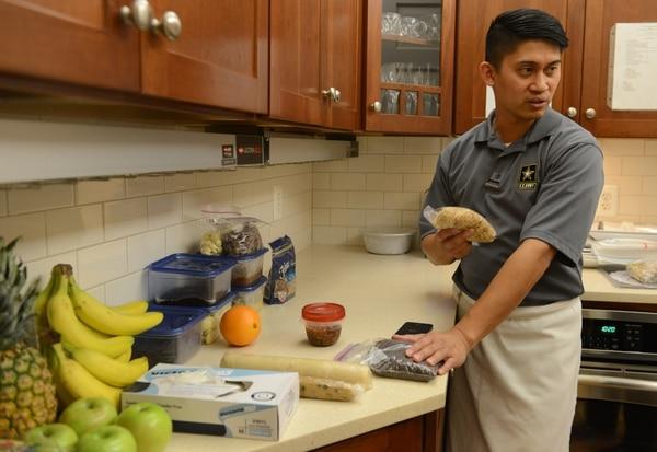 Photo Credit: David Vergun Staff Sgt. Marc Susa prepares a meal.